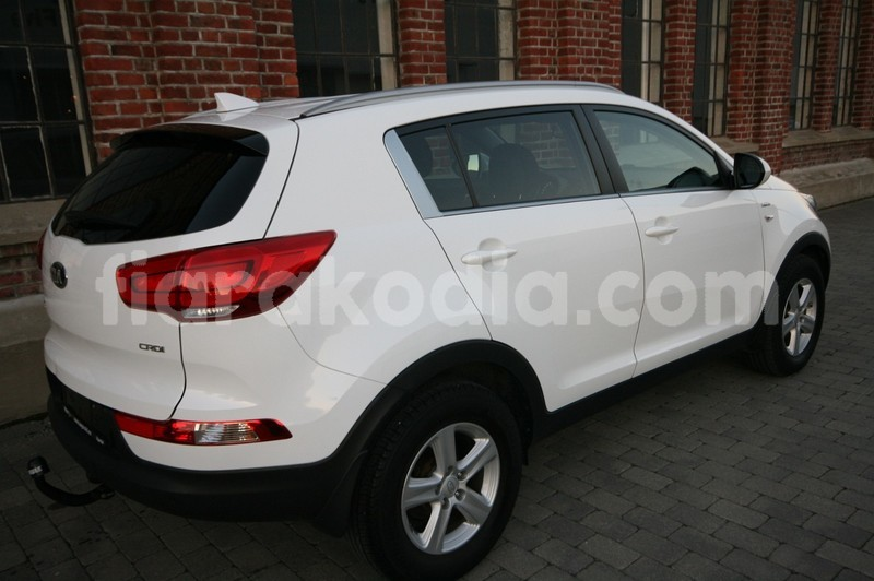 Big with watermark kia sportage 4